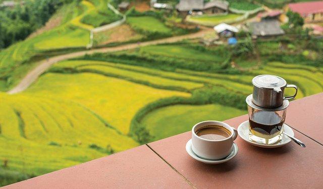 Drip Black Coffee vietnamese style on balcony with alpine backgr